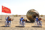 In this photo released by Xinhua News Agency, Chinese astronauts from left, Tang Hongbo, Nie Haisheng and Liu Boming wave at the Dongfeng landing site in northern China's Inner Mongolia Autonomous Region on Friday, Sept. 17, 2021. The trio of Chinese astronauts returned to Earth on Friday after a 90-day stay aboard their nation's first space station in China's longest mission yet.(Ju Zhenhua/Xinhua via AP)