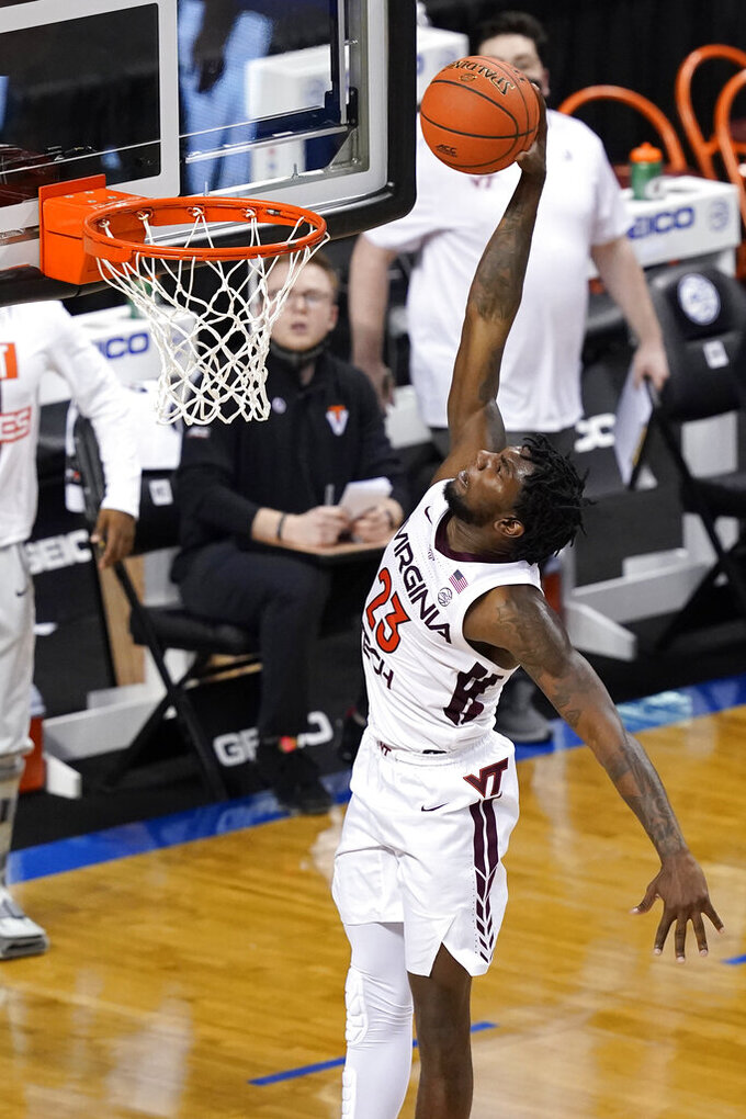 Virginia Tech guard Tyrece Radford (23) dunks during the second half of an NCAA college basketball game against North Carolina in the quarterfinal round of the Atlantic Coast Conference tournament in Greensboro, N.C., Thursday, March 11, 2021. (AP Photo/Gerry Broome)