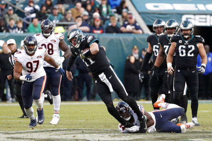 Philadelphia Eagles' Carson Wentz (11) is tackled by Chicago Bears' Leonard Floyd (94) during the second half of an NFL football game, Sunday, Nov. 3, 2019, in Philadelphia. (AP Photo/Chris Szagola)