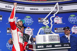 Chase Elliott, left, pumps his fist in Victory Lane after winning a NASCAR Cup Series auto race at Circuit of the Americas in Austin, Texas, Sunday, May 23, 2021. (AP Photo/Chuck Burton)