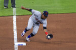 Cleveland Indians' Jose Ramirez fields the ball before throwing out Cincinnati Reds' Nick Senzel at first base during the second inning of a baseball game in Cincinnati, Friday, April 16, 2021. (AP Photo/Aaron Doster)