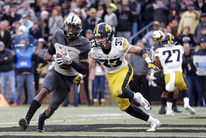 Purdue wide receiver Terry Wright, left, scores a touchdown in front of Iowa defensive back Riley Moss (33) in the second half of an NCAA college football game in West Lafayette, Ind., Saturday, Nov. 3, 2018. (AP Photo/AJ Mast)