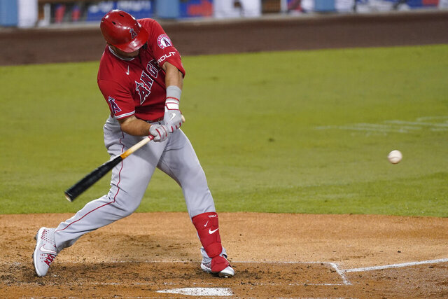 Los Angeles Angels' Mike Trout hits a home run during the third inning of the team's baseball game against the Los Angeles Dodgers on Friday, Sept. 25, 2020, in Los Angeles. (AP Photo/Ashley Landis)