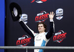 Colton Herta acknowledges cheers from fans after winning the IndyCar Classic auto race, Sunday, March 24, 2019, in Austin, Texas. (AP Photo/Eric Gay)