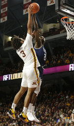 Minnesota forward Jordan Murphy (3) has his shot blocked by Mount St. Mary's forward Collin Nnamene (21) during the first half of an NCAA basketball game Sunday, Dec. 30, 2018, in Minneapolis. (AP Photo/Paul Battaglia)