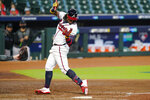 Atlanta Braves' Ronald Acuna Jr. (13) is hit by a pitch by Miami Marlins starting pitcher Sandy Alcantara during the third inning in Game 1 of a baseball National League Division Series Tuesday, Oct. 6, 2020, in Houston. (AP Photo/Eric Gay)