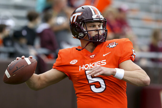 Virginia Tech quarterback Ryan Willis warms up for the NCAA college football team's Maroon-White spring game in Blacksburg, Va., Saturday, April 13, 2019. (Matt Gentry/The Roanoke Times via AP)