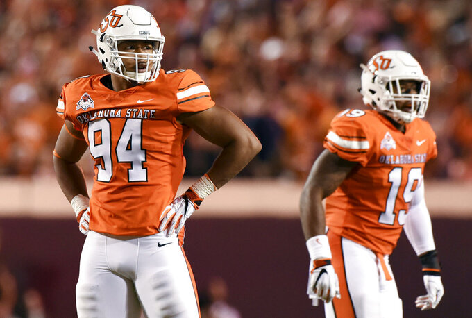 FILE - In this Oct. 27, 2018, file photo, Oklahoma State defensive end Jordan Brailford, left, looks to the sideline during an NCAA college football game in Stillwater, Okla. Brailford has enjoyed an outstanding season, ranking among the nation's top 10 in sacks and tackles for loss this season. (AP Photo/Brody Schmidt, File)