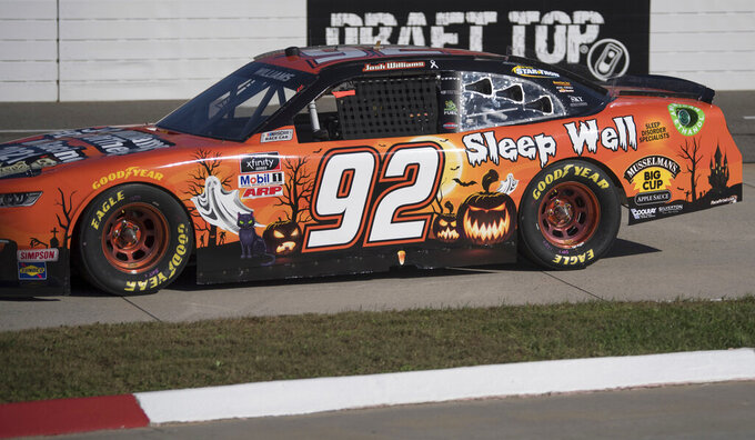 Josh Williams (92) drives a Halloween-themed car during a NASCAR Xfinity Series auto race at Martinsville Speedway in Martinsville, Va., Saturday, Oct. 31, 2020. (AP Photo/Lee Luther Jr.)
