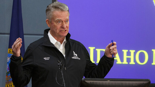 Idaho Gov. Brad Little issues a statewide stay-at-home order to further prevent spread of coronavirus at a press conference, Wednesday, March 25, 2020 held at Gowen Field, headquarters of the Idaho Army National Guard in Boise, Idaho. (Darin Oswald/Idaho Statesman via AP)