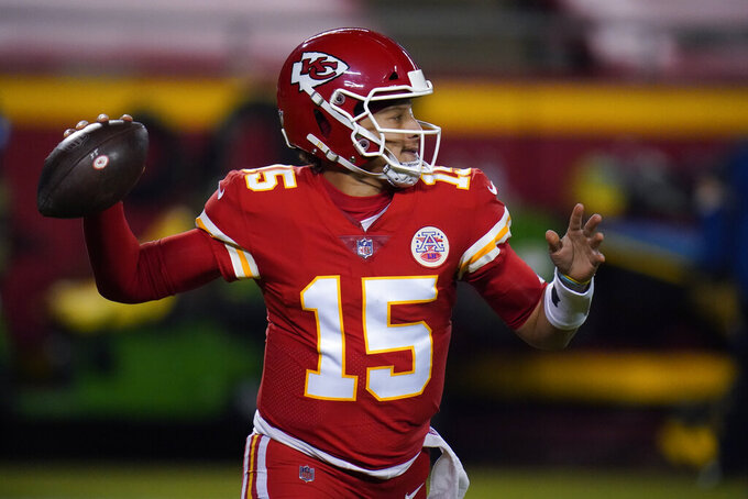 Kansas City Chiefs quarterback Patrick Mahomes (15) throws against the Denver Broncos in the first half of an NFL football game in Kansas City, Mo., Sunday, Dec. 6, 2020. (AP Photo/Jeff Roberson)
