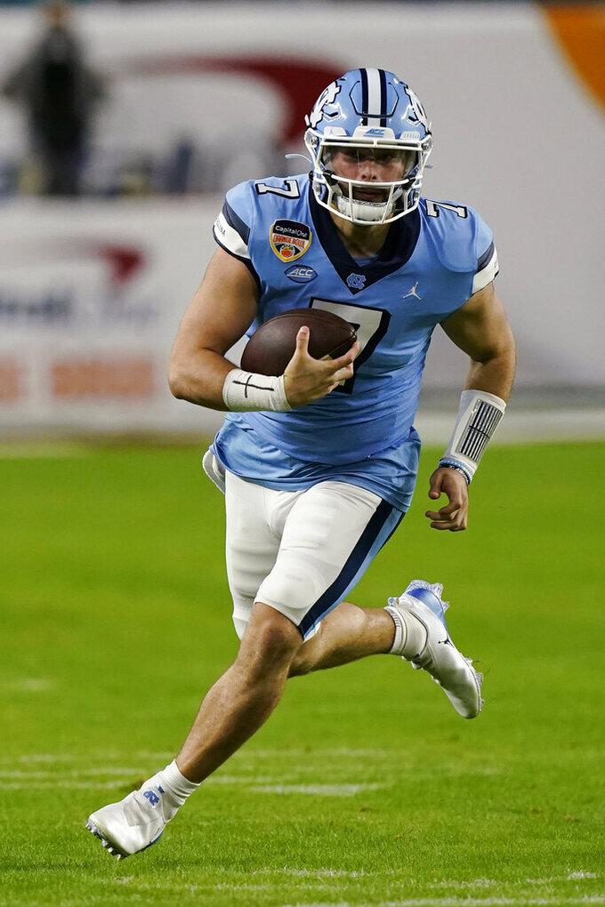 North Carolina quarterback Sam Howell (7) runs the football during the first half of the Orange Bowl NCAA college football game against Texas A&M, Saturday, Jan. 2, 2021, in Miami Gardens, Fla. (AP Photo/Marta Lavandier)