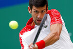 Novak Djokovic of Serbia hits a return shot to Marco Cecchinato of Italy during their men's singles match of the Shanghai Masters tennis tournament at Qizhong Forest Sports City Tennis Center in Shanghai, China, Thursday, Oct. 11, 2018. (AP Photo/Andy Wong)