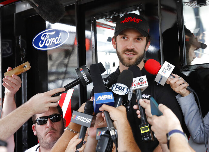 Daniel Suarez talks to the media before practice for a NASCAR Cup Series auto race on Friday, Nov. 15, 2019, at Homestead-Miami Speedway in Homestead, Fla. Suarez has been fired for the second time in a year, this time by Stewart-Haas Racing as it makes room to promote Cole Custer to the Cup Series in 2020. (AP Photo/Terry Renna)