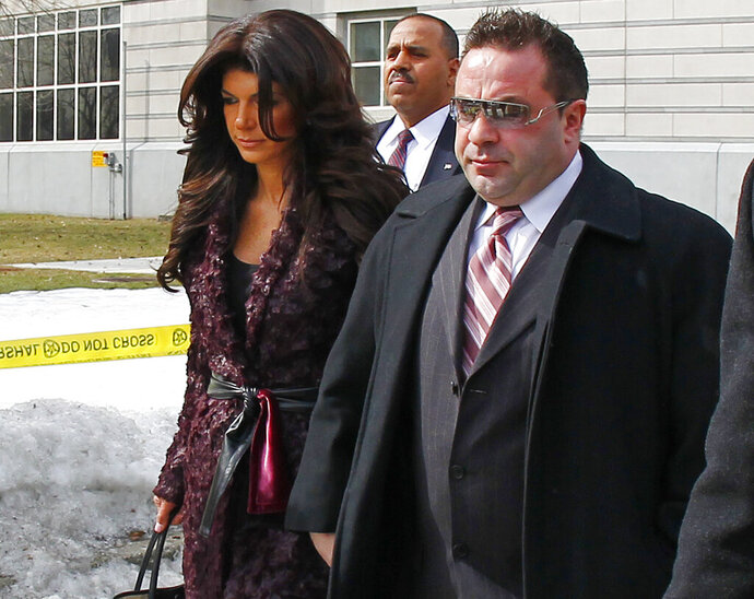 FILE - This March 4, 2014 file photo shows Teresa, left, and Joe Giudice, from