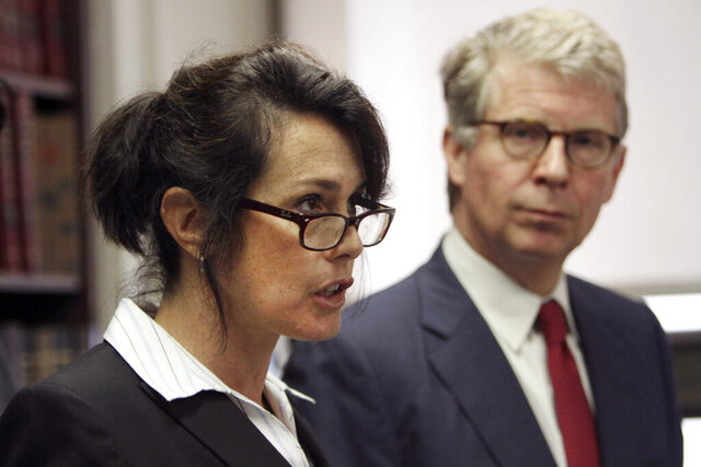 FILE - This June 17, 2011 file photo shows Manhattan District Attorney Cyrus R. Vance Jr., right, as he listens while New York City Police Department Narcotics Inspector Lori Pollock speaks to reporters during a news conference, in New York. Pollock, a former chief who was one of the NYPD's highest-ranking female police officials, accused the department of denying women the opportunity to advance to senior leadership posts in a federal lawsuit. (AP Photo/Mary Altaffer, File)