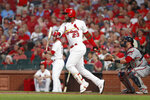 St. Louis Cardinals' Marcell Ozuna (23) follows through on a two-run home run during the first inning of a baseball game against the Washington Nationals, Monday, Sept. 16, 2019, in St. Louis. (AP Photo/Jeff Roberson)