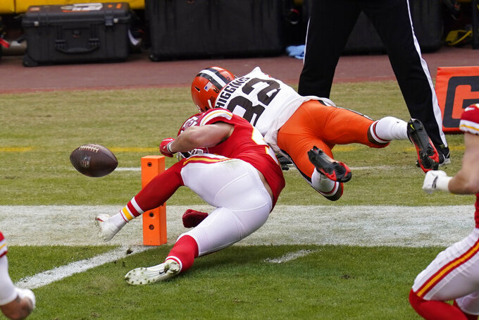 Cleveland Browns wide receiver Rashard Higgins (82) fumbles the ball over Kansas City Chiefs safety Daniel Sorensen at the goal line during the first half of an NFL divisional round football game, Sunday, Jan. 17, 2021, in Kansas City. (AP Photo/Orlin Wagner)