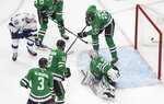 Tampa Bay Lightning left wing Ondrej Palat, top left, scores on Dallas Stars goaltender Anton Khudobin (35) during the second period of Game 3 of the NHL hockey Stanley Cup Final, Wednesday, Sept. 23, 2020, in Edmonton, Alberta. (Jason Franson/The Canadian Press via AP)