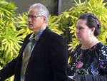 FILE - In this March 4, 2019 file photo, retired Honolulu police chief Louis Kealoha, and his wife, former deputy prosecutor Katherine Kealoha, walk into the U.S. courthouse in Honolulu. In closing arguments beginning Tuesday, June 25, prosecutors say the former Honolulu police chief and his wife, a former deputy prosecutor, abused their positions in an attempt to silence a relative who could have exposed the financial fraud that funded their lavish lifestyle. (AP Photo/Jennifer Sinco Kelleher, File)