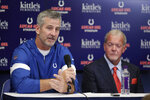 Indianapolis Colts coach Frank Reich speaks as team owner Jim Irsay listens following a news conference after the Colts' NFL preseason football game against the Chicago Bears, Saturday, Aug. 24, 2019, in Indianapolis. Colts quarterback Andrew Luck announced that he his retiring at age 29. (AP Photo/Michael Conroy)