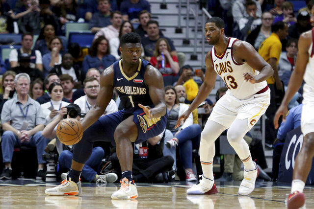 New Orleans Pelicans forward Zion Williamson (1) drives as Cleveland Cavaliers center Tristan Thompson (13) defends during the first half of an NBA basketball game in New Orleans, Friday, Feb. 28, 2020. (AP Photo/Rusty Costanza)