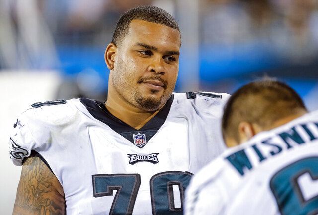FILE - In this Oct. 12, 2017, file photo, Philadelphia Eagles' Brandon Brooks (79) sits on the bench during the second half of an NFL football game against the Carolina Panthers in Charlotte, N.C. Brooks said pressure of trying to live up to a new contract led to an anxiety attack that forced him out of the Philadelphia Eagles' game last Sunday, Nov. 24, 2019. Brooks has dealt with anxiety for several years but has started 50 straight games, including the playoffs. But he recently signed a four-year, $54.2 million contract and it weighed on his mind. (AP Photo/Bob Leverone, File)