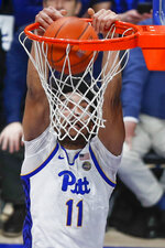 Pittsburgh's Justin Champagnie (11) makes a dunk against Syracuse during the second half of an NCAA college basketball game, Wednesday, Feb. 26, 2020, in Pittsburgh. (AP Photo/Keith Srakocic)