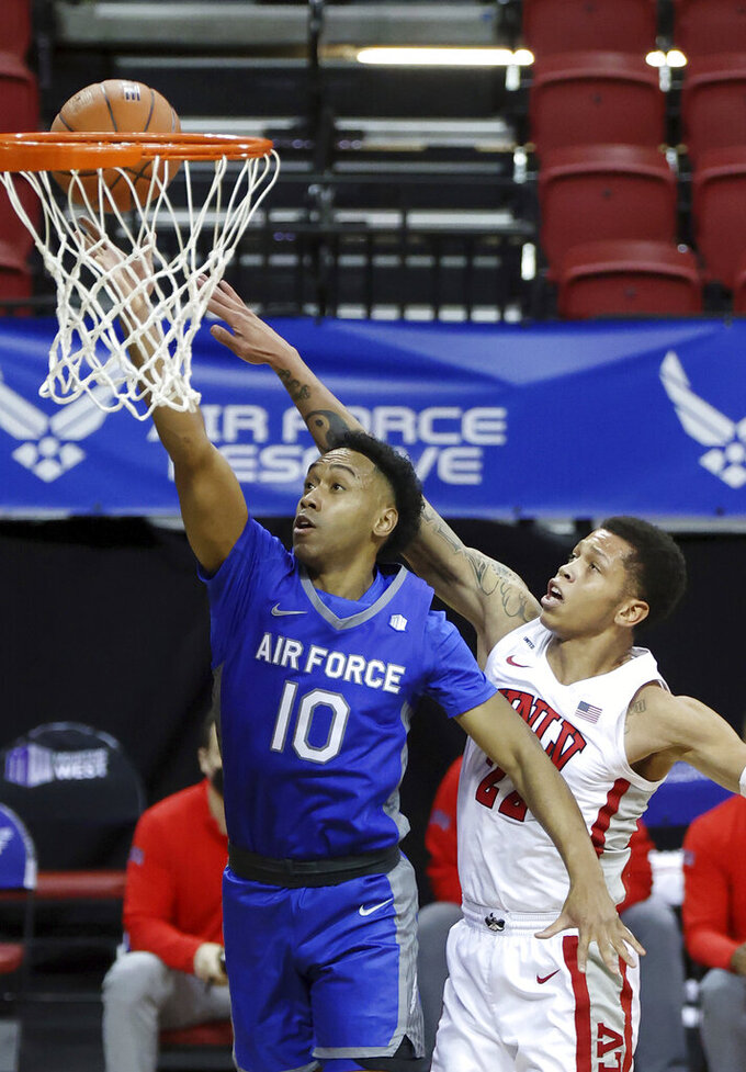 Air Force guard A.J. Walker (10) shoots as UNLV guard Nicquel Blake (22) defends during the first half of an NCAA college basketball game in the first round of the Mountain West Conference men's tournament Wednesday, March 10, 2021, in Las Vegas. (AP Photo/Isaac Brekken)