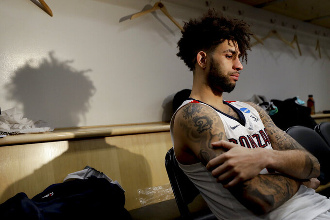 Gonzaga guard Josh Perkins talks to the media after the team's loss to Texas Tech during the West Regional final in the NCAA men's college basketball tournament Saturday, March 30, 2019, in Anaheim, Calif. Texas Tech won 75-69. (AP Photo/Jae C. Hong)