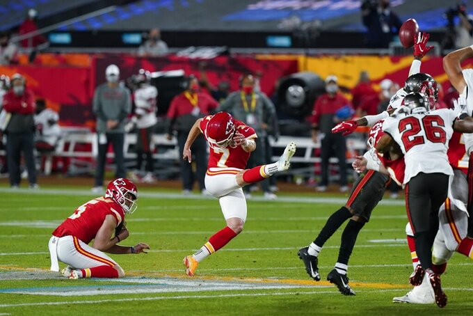 Kansas City Chiefs kicker Harrison Butker (7) kicks a field goal against the Tampa Bay Buccaneers during the first half of the NFL Super Bowl 55 football game Sunday, Feb. 7, 2021, in Tampa, Fla. (AP Photo/Mark Humphrey)