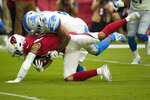 Arizona Cardinals wide receiver Damiere Byrd is tackled by Detroit Lions defensive back Quandre Diggs, right, during the first half of an NFL football game, Sunday, Sept. 8, 2019, in Glendale, Ariz. (AP Photo/Rick Scuteri)