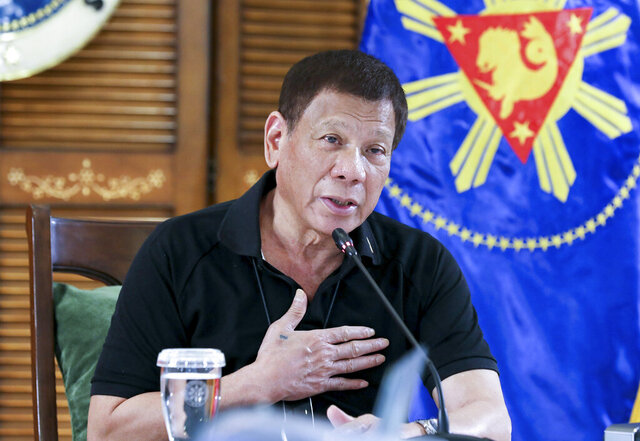 In this photo provided by the Malacanang Presidential Photographers Division, Philippine President Rodrigo Duterte attends a meeting with members of the Inter-Agency Task Force on the Emerging Infectious Diseases in Davao province, southern Philippines late Monday Aug. 17, 2020. Duterte has decided to ease a mild lockdown in the capital and four outlying provinces to further reopen the country's battered economy in a high-risk gamble despite having the highest number of coronavirus infections in Southeast Asia.(Robinson Ninal Jr./Malacanang Presidential Photographers Division via AP)