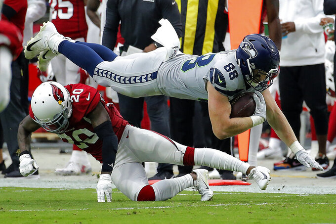 Seattle Seahawks tight end Will Dissly (88) is hit by Arizona Cardinals defensive back Tramaine Brock (20) during the first half of an NFL football game, Sunday, Sept. 29, 2019, in Glendale, Ariz. (AP Photo/Rick Scuteri)