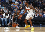 Brooklyn Nets guard Kyrie Irving, left, picks up a loose ball as Denver Nuggets forward Will Barton defends in the second half of an NBA basketball game Thursday, Nov. 14, 2019 in Denver. The Nuggets won 101-93. (AP Photo/David Zalubowski)