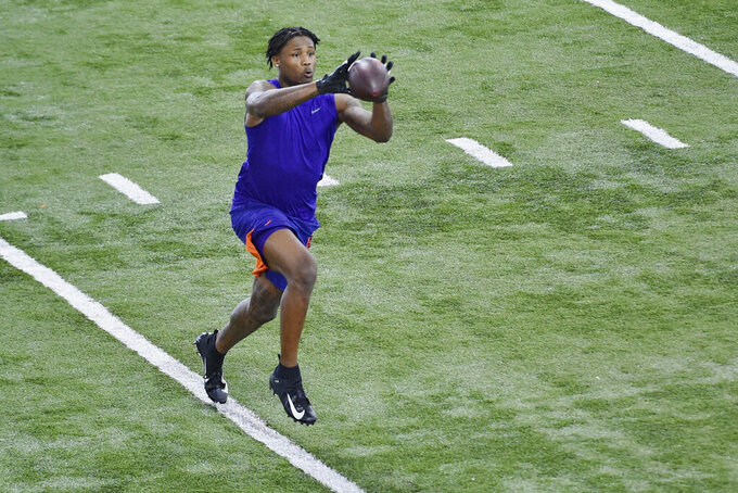 Clemson football player Tee Higgins catches a pass during NFL Pro Day Thursday, March 12, 2020, in Clemson, S.C. (AP Photo/Richard Shiro)