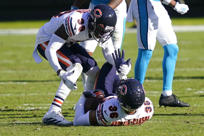 Chicago Bears free safety Eddie Jackson (39) congratulates defensive back DeAndre Houston-Carson (36) following Carson's interception against the Carolina Panthers during the second half of an NFL football game in Charlotte, N.C., Sunday, Oct. 18, 2020. (AP Photo/Brian Blanco)