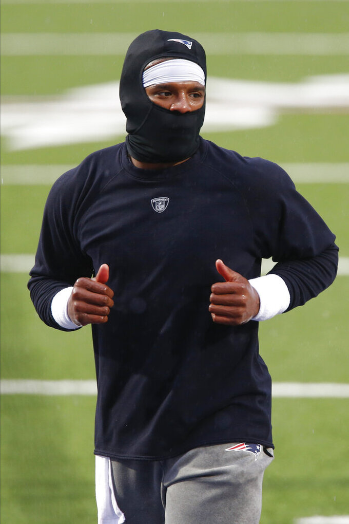 New England Patriots quarterback Cam Newton warms up before an NFL football game against the Buffalo Bills Sunday, Nov. 1, 2020, in Orchard Park, N.Y. (AP Photo/John Munson)