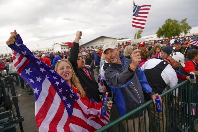 Fans cheer during the opening ceremony for the Ryder Cup at the Whistling Straits Golf Course Thursday, Sept. 23, 2021, in Sheboygan, Wis. (AP Photo/Ashley Landis)