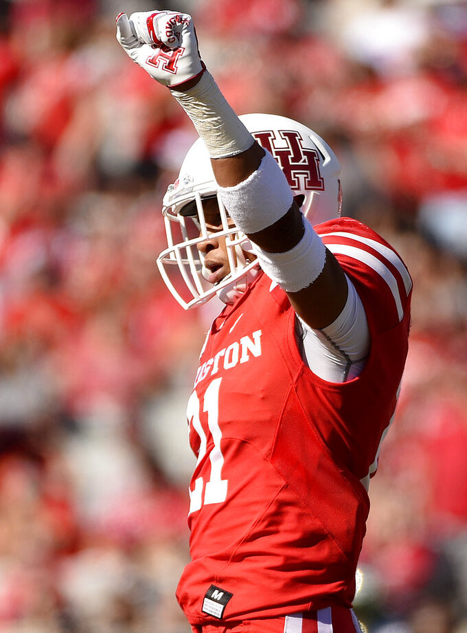 King totals 7 TDs, Houston beats No. 21 USF 57-36