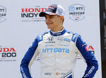 FILE - Alex Palou smiles in victory lane after placing third in an IndyCar race at Mid-Ohio Sports Car Course in Lexington, Ohio, in this Sunday, July 4, 2021, file photo. IndyCar begins its final month of competition with a surprise new face trying to close out the championship. Palou takes a 21-point lead into Saturday night's race at World Wide Technology Raceway outside St. Louis. (AP Photo/Tom E. Puskar, File)