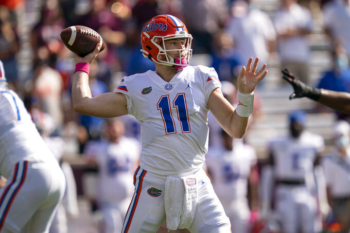 Florida quarterback Kyle Trask (11) pass down field during the first quarter of an NCAA college football game against Texas A&M, Saturday, Oct. 10, 2020. in College Station, Texas. (AP Photo/Sam Craft)