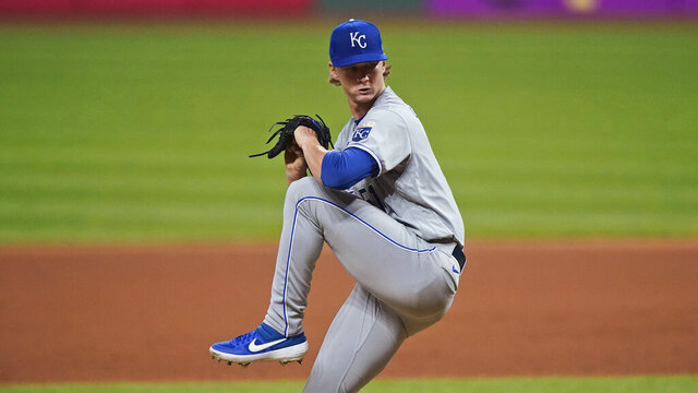 Kansas City Royals starting pitcher Brady Singer winds up during the seventh inning of the team's baseball game against the Cleveland Indians, Thursday, Sept. 10, 2020, in Cleveland. (AP Photo/Tony Dejak)
