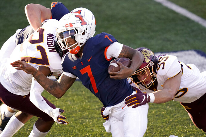 Minnesota defensive back Tyler Nubin (27) and linebacker Mariano Sori-Marin (55) tackle Illinois quarterback Coran Taylor during the first half of an NCAA college football game Saturday, Nov. 7, 2020, in Champaign, Ill. (AP Photo/Charles Rex Arbogast)