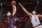 Utah guard Rylan Jones, left, shoots as Stanford forward Oscar da Silva (13) defends during the second half during an NCAA college basketball game Thursday, Feb. 6, 2020, in Salt Lake City. (AP Photo/Rick Bowmer)
