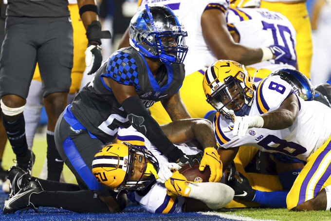 LSU running back Tyrion Davis-Price, center, waits for confirmation of his touchdown during the second half of the team's NCAA college football game against Kentucky in Lexington, Ky., Saturday, Oct. 9, 2021. (AP Photo/Michael Clubb)
