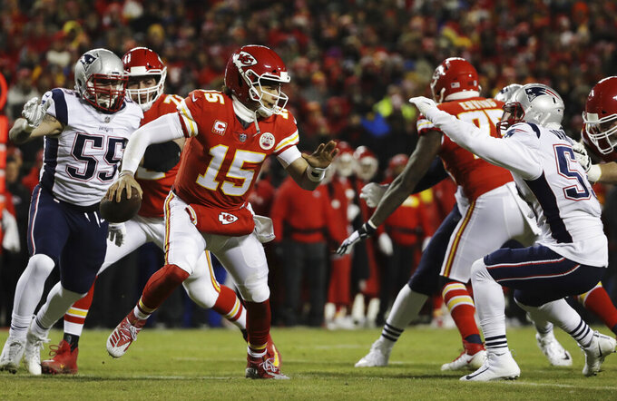 Kansas City Chiefs quarterback Patrick Mahomes (15) runs from New England Patriots middle linebacker Kyle Van Noy (53) during the first half of the AFC Championship NFL football game, Sunday, Jan. 20, 2019, in Kansas City, Mo. (AP Photo/Elise Amendola)
