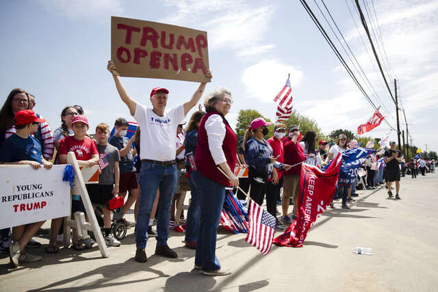 Supporters line the side of the road waiting for the motorcade of President Donald Trump to drive past on Thursday, May 14, 2020, in Allentown, Pa. (AP Photo/Matt Rourke)