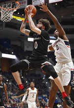 Cincinnati's Logan Johnson makes a basket as Connecticut's Eric Cobb (0) defends during the first half of an NCAA college basketball game, Sunday, Feb. 24, 2019, in Hartford, Conn. (AP Photo/Jessica Hill)