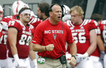 FILE - In this Oct. 6, 2018, file photo, North Carolina State coach Dave Doeren reacts during the second half the team's NCAA college football game against Boston College in Raleigh, N.C. Doeren's team hosts East Carolina on Saturday in a game added to the schedule after a September game against West Virginia was canceled due to Hurricane Florence. (AP Photo/Gerry Broome, File)